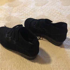 Black dudes Dansko shoe boots.